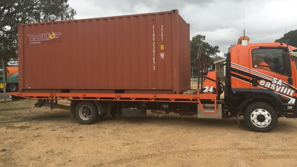 Storage shipping container on truck