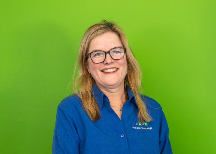 Female staff member smiling