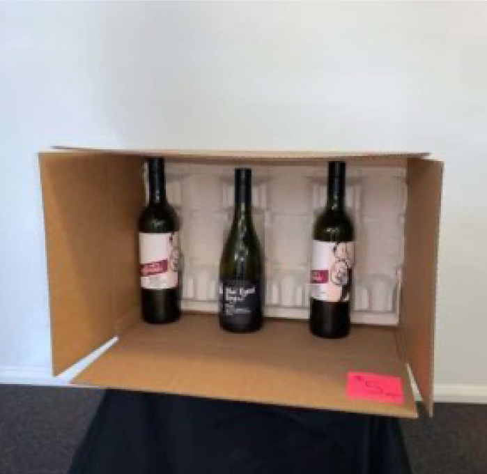 storage box with standing wine bottles and polystyrene padding